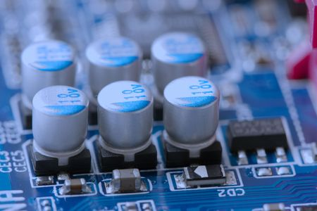mainboard: Small electronic components on a mainboard Stock Photo