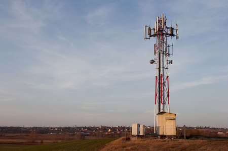 gsm: GSM transmitter tower in the countryside Stock Photo