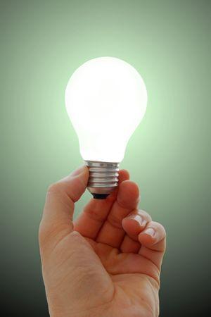 Glowing lightbulb in hand Banco de Imagens