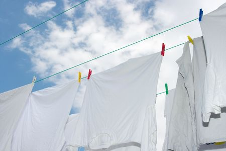 clothespegs: White clothes drying on the rope