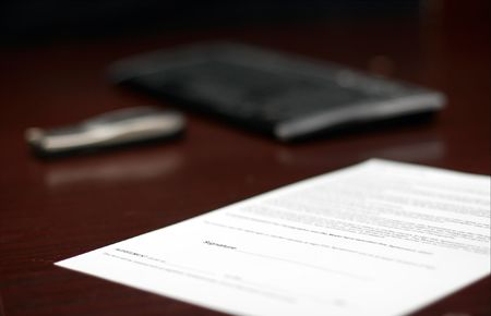 Contract on a table, shallow DoF photo