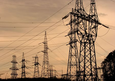voltage gray: Many high voltage electric lines in the dusk Stock Photo