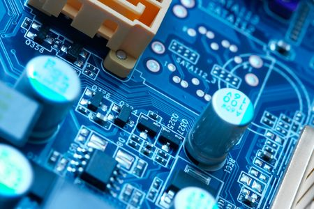 electrical components on a computer mainboard photo