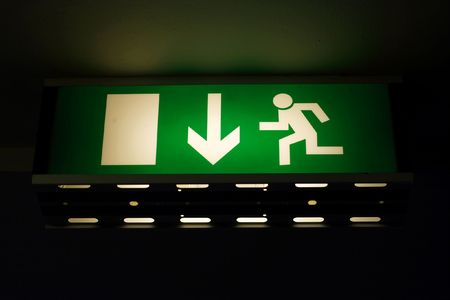 Green, glowing emergency exit sign Stock Photo - 3065017