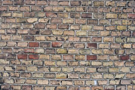 Old wall of small bricks photo