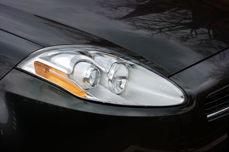 Headlights of a black car photo
