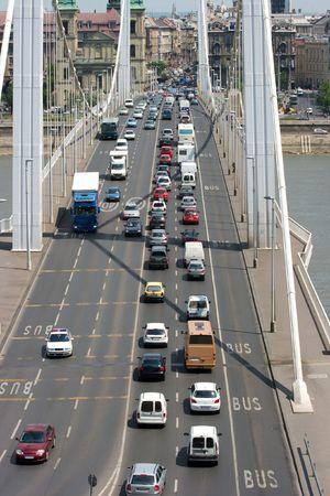 slow lane: Heavy traffic going throug a bridge Stock Photo