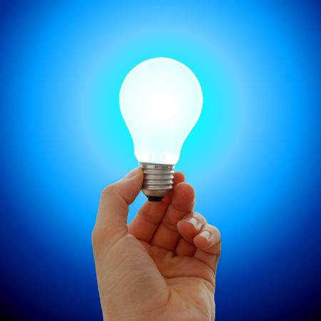 Glowing lightbulb in a hand Stock Photo - 3065099