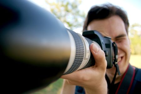 Crazy photographer using telephoto lens photo