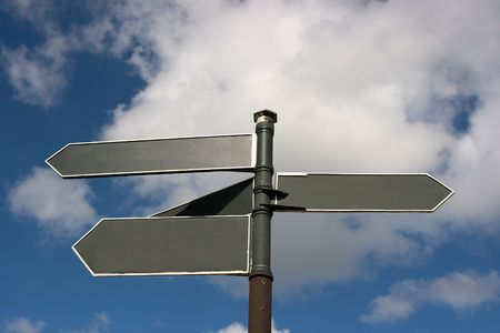 Blank signpost showing different directions Banco de Imagens