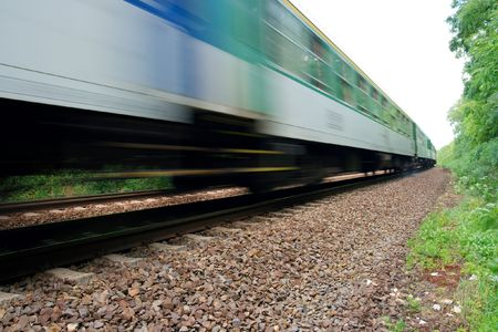 Fast train passing by with motion blur photo