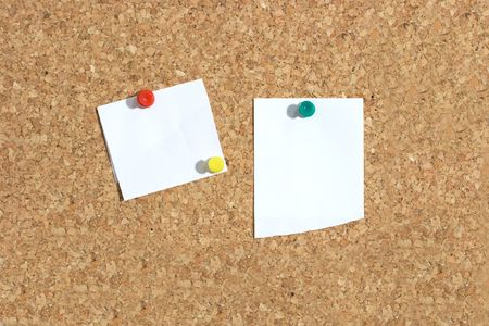 Blank papers pinned to a cork board photo