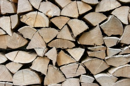 Pile of logs cut to pieces photo