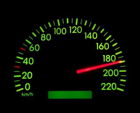 Speedometer showing 190, glowing green in the dark photo