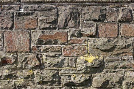Edad de Piedra: Dark muro de piedra de textura  Foto de archivo
