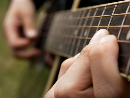 Fingers of a guitar player, shallow DoF Stock Photo - 3555515