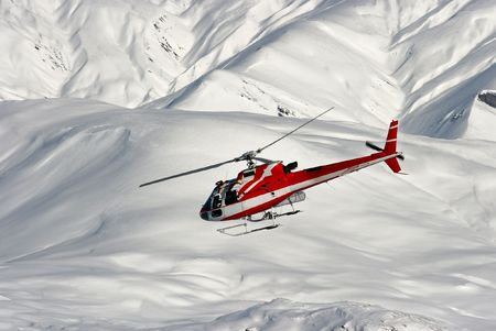 heli: Mountain rescue helicopter on a snowy landscape