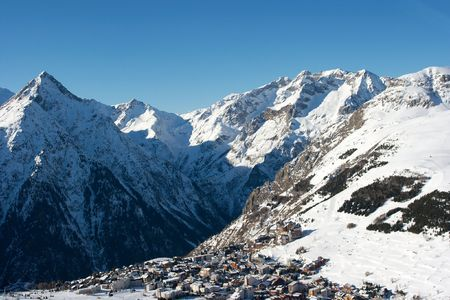 High mountains in the french alps with a town Stock Photo - 3555541