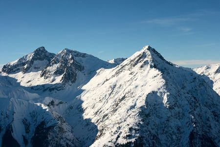 High mountain range with snow and blue sky Stock Photo - 3603428