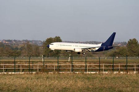 Aircraft landing on the runway Stock Photo - 3603510