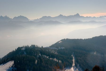 Mountain range fading into the fog in the distance photo