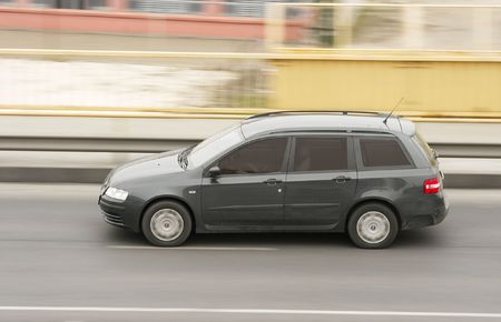 Car going on a road with motion blur Stock Photo - 3624413