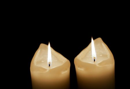 mood moody: Two candles burning in the night, black background