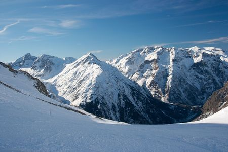 High mountain range covered by snow photo