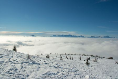 Snowy slopes on a mountain above the clouds Stock Photo - 3762214