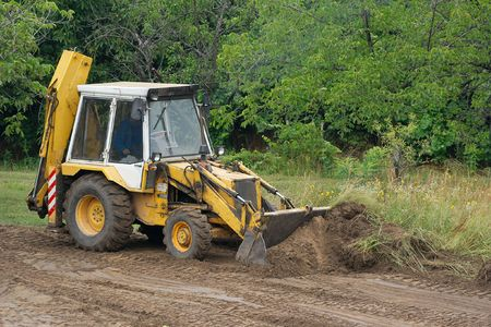 Excavator moving soil at a road construction Stock Photo - 3800334