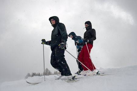 Skiers in the falling snow Stock Photo - 3791094