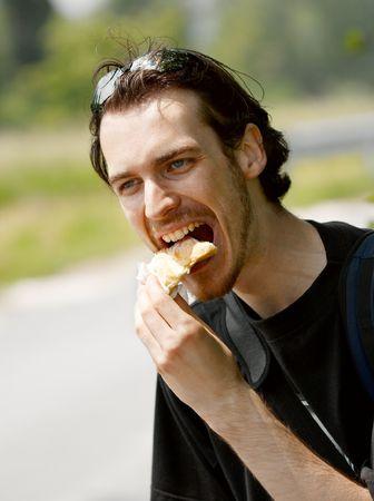 devour: Man eating outdoors