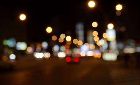city lights: Out of focus lights of urban traffic in a city