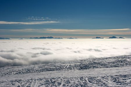 High mountain range above the clouds Stock Photo - 3841631