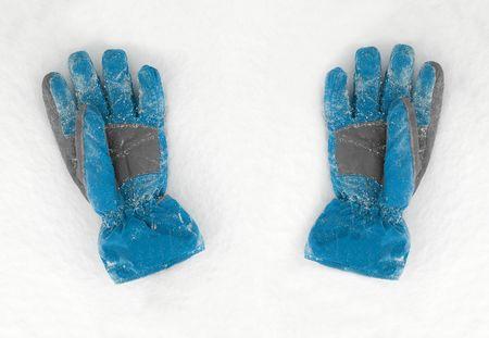 seasonic: A pair of gloves on the fresh snow Stock Photo