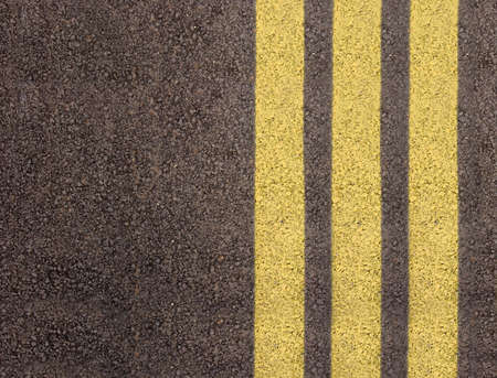 rough road: Asphalt texture with yellow lines