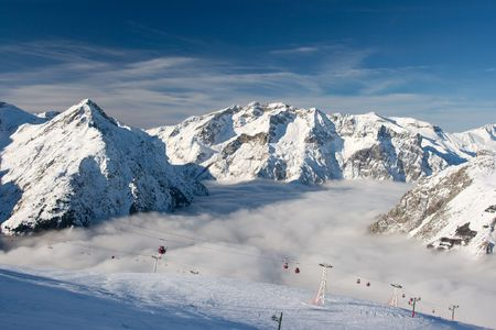 High mountains with skilift cabins photo