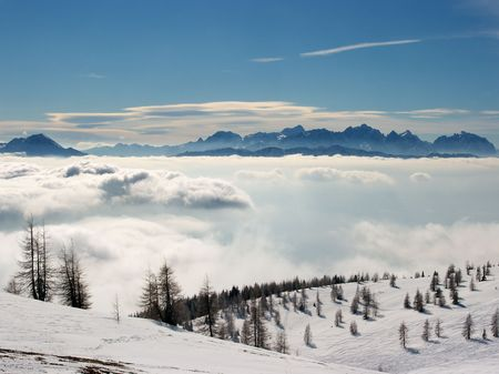 High mountain landscape above the clouds photo