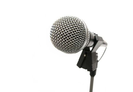 Microphone on stand isolated on white background photo