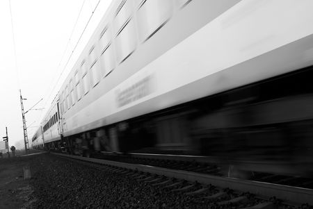 Passenger train passing by with motion blur photo