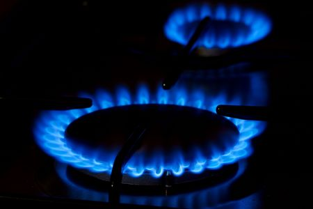 ble: Ble gas flame of on oven in the dark Stock Photo