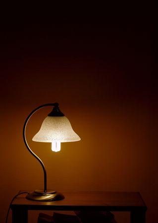 Lamp on a table illuminating the night photo