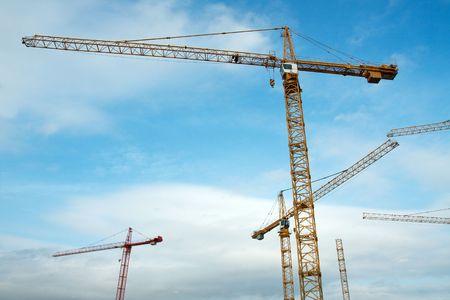 construction crane: Tower cranes against blue sky