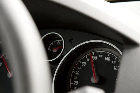 Dashboard of a car, focus on the speedometer showing 95 photo