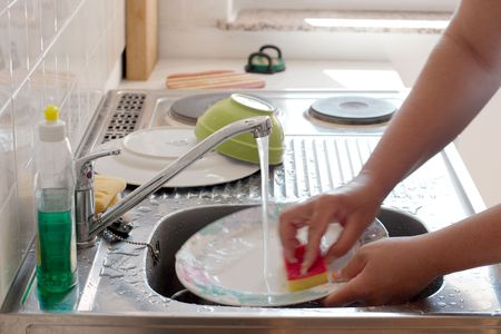 Washing dishes in the kitchen Stock Photo - 4495506