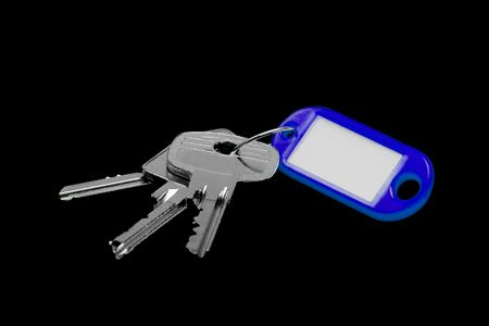 Bunch of keys with blank label isolated on black photo