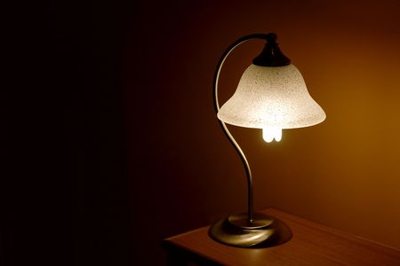 Small reading lamp in the night photo