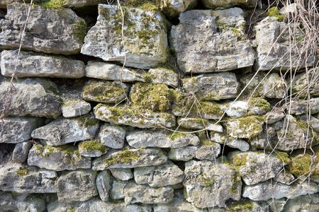 Old stone wall of a medieval building photo