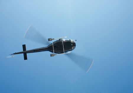 heli: Black helicopter flying in the air
