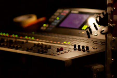 amplification: Soundboard mixer at a concert, shallow focus Stock Photo